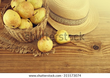 Autumn nature concept. Fall pears on wood. - stock photo