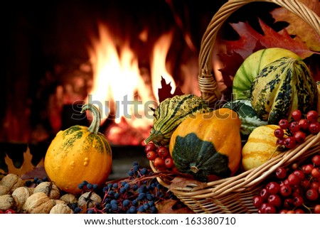 Autumn nature concept with colorful pumpkins in basket - stock photo