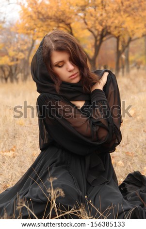 Autumn outdoor portrait of young thoughtful woman