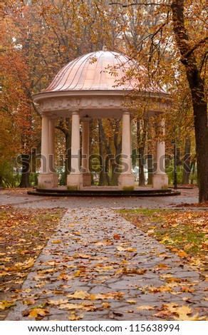 Autumn park with a footpath to summer house. The Lvov park - stock photo