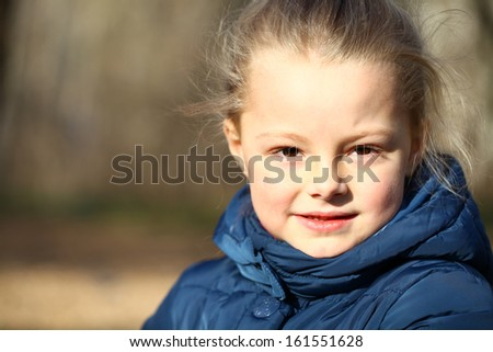 Autumn portrait of a beautiful young girl on the street - stock photo