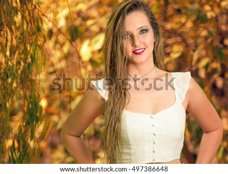 Autumn Portrait of a young beautiful woman