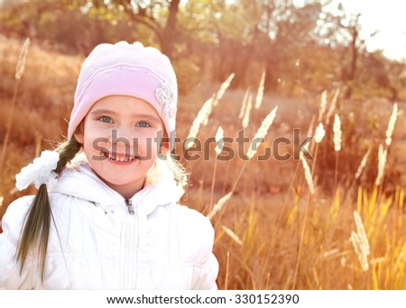 Autumn portrait of adorable little girl outdoor