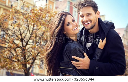 Autumn portrait of attractive happy couple  - stock photo