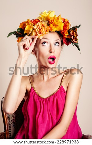 Autumn portrait of blonde beautiful woman with flowers on head.  - stock photo