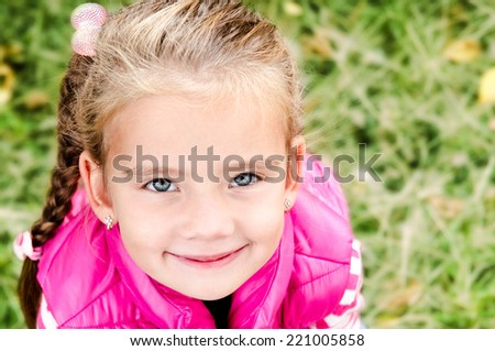Autumn portrait of cute smiling little girl outdoor - stock photo