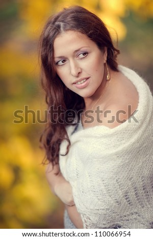 Autumn portrait of happy lovely and beautiful caucasian young woman in forest in fall color - stock photo