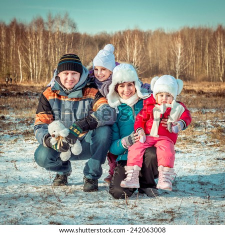 Autumn  portrait of happy young family - stock photo