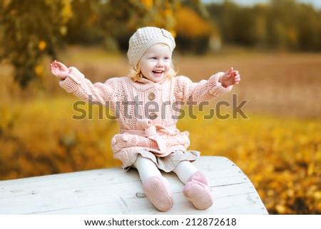 Autumn portrait positive child having fun - stock photo