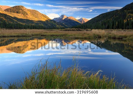 Autumn reflection in the Bear River, Utah, USA. - stock photo