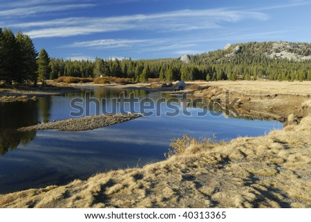 Autumn reflections at Tuolumne River in Yosemite National Park, California