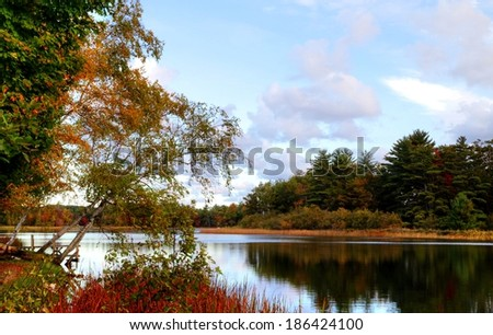 Autumn Reflections. Freshwater lake with fall foliage reflections. Ludington State Park. Ludington, Michigan.  - stock photo