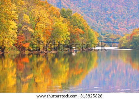 Autumn reflections in Kanawha river West Virginia - stock photo