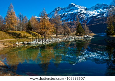Autumn reflections on the lake Silvaplana