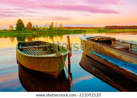 Autumn River And Old Green Rowing Boats. Russian Landscape, Nature - stock photo