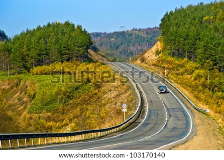 Autumn road. - stock photo