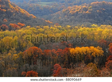 Autumn scene: Colorful trees and hills in bluff country along Mississippi River, Iowa - stock photo