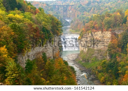 Autumn scene of the middle falls and gorge at Letchworth State Park - stock photo