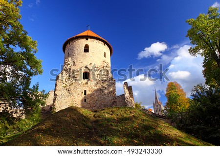 autumn scenery of medieval baltic castle on a hill