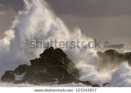 Autumn sea storm at sunset with splash from atlantic big waves over cliffs from the northern portuguese coast
