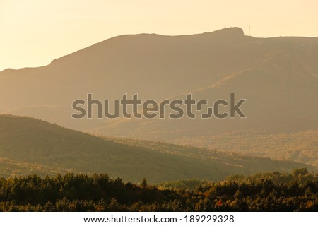 Autumn shot looking across the valley to Mt. Mansfield in the scenic Stowe Vermont, USA - stock photo