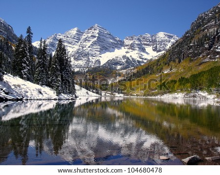 Autumn snowfall on the Maroon Bells.   Aspen, CO - stock photo