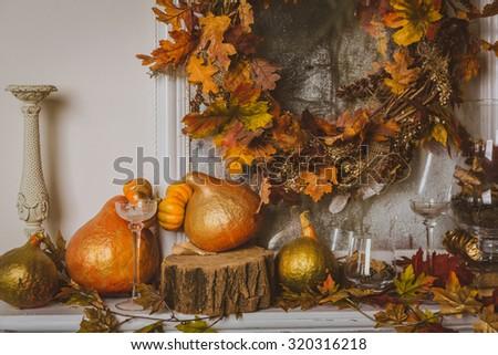 Autumn still life on the mantelpiece - stock photo