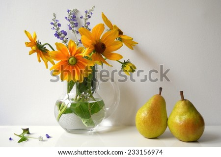 Autumn still life with black eyed susan flowers and pears. Fall decoration. - stock photo