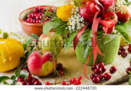 Autumn still life with flowers and fruits . Selective focus - stock photo