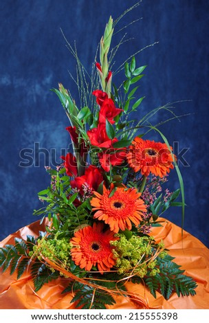 Autumn Still life with gerbera and gladiolus flowers  - stock photo