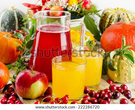 Autumn still life with juice, fruit, berries and vegetables. Selective focus - stock photo