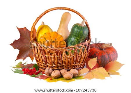 Autumn still-life with pumpkins in basket, isolated on white - stock photo
