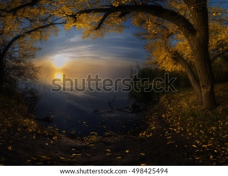 Autumn sunrise on the river foggy morning panorama