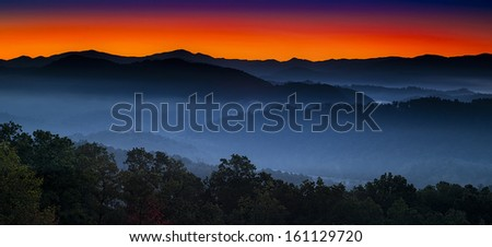 Autumn sunrise view of layered misty mountains  in Great Smoky Mountains National Park