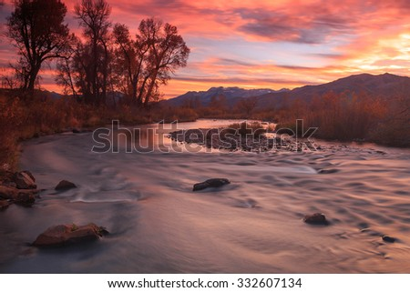Autumn sunset at the Provo River, Heber Valley, Utah, USA. - stock photo