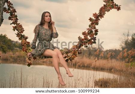 Autumn swings - stock photo