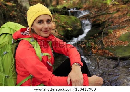Autumn trek - woman on mountain hike - stock photo