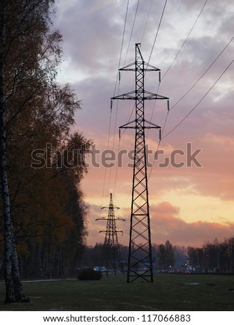 Autumn urban landscape with a power line