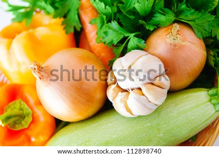 Autumn vegetables background: garlic, parsley, pepper, onion, carrot, squash