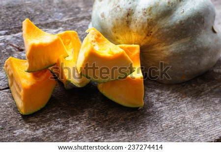 Autumn vegetables - fried pumpkin on the wooden table