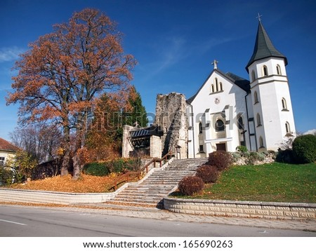 Autumn view of Church of The Holy Trinity. This Gothic church build in 13-th century is dominant landmark of Mosovce. Church of Holy Trinity declared as national cultural heritage of Slovakia.