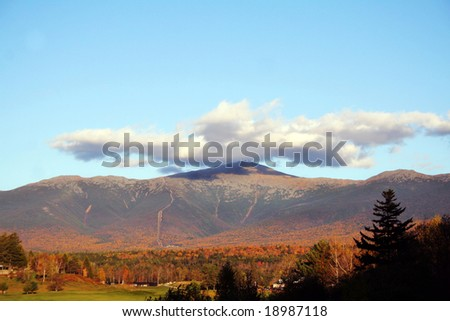 Autumn view of Mount Washington, New Hampshire.  This is the highest peak in the northeastern US.  Structure visible at top is a weather observatory. - stock photo