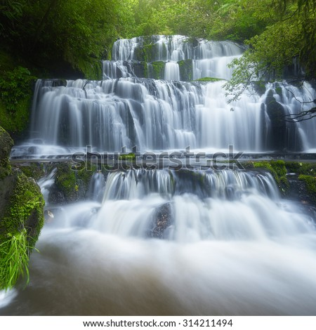 Autumn view of Purakaunui Falls, located in The Catlins in the southern South Island of New Zealand. - stock photo