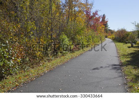 Autumn view of the Ashuwillticook rail to trail in the Berkshire Mountains of Western Massachusetts. - stock photo