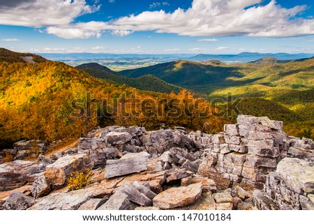 Autumn view of the Shenandoah Valley and Blue Ridge Mountains from the boulder-covered summit of Blackrock, in Shenandoah National Park, VA. - stock photo