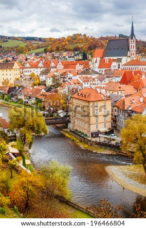 Autumn view on the Cesky Krumlov a bridge over Vltava river - stock photo