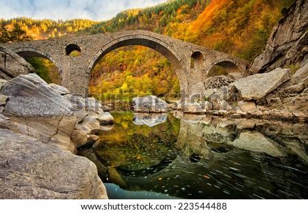 Autumn view with The Devil's Bridge, Bulgaria - stock photo