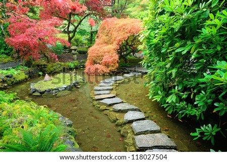 autumn vivid colors of Japanese garden inside the national historical site butchart garden in Vancouver island, British Columbia, Canada - stock photo