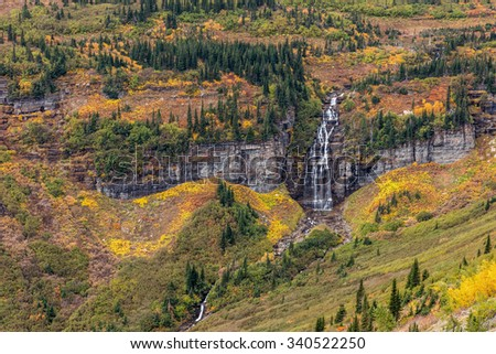 Autumn Waterfall in Glacier National Park, Montana - stock photo