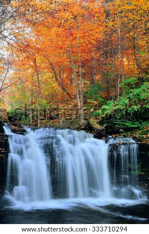 Autumn waterfalls in park with colorful foliage. - stock photo